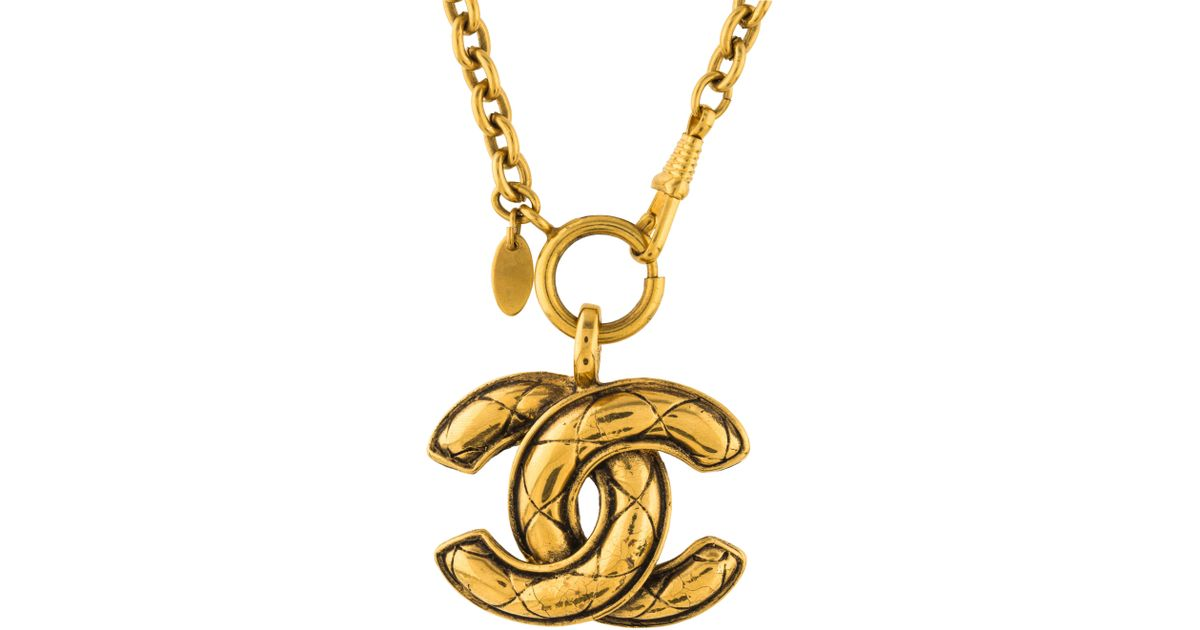 Lyst chanel cc quilted pendant necklace gold in metallic aloadofball Images