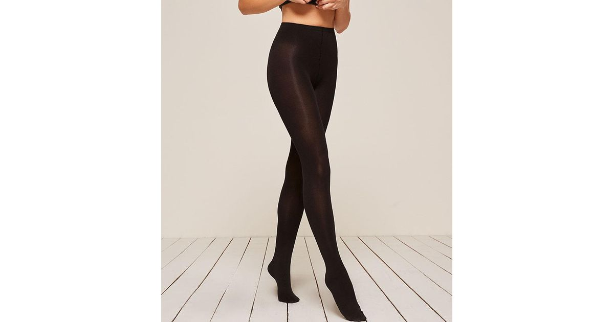 d0be7f6efbf Lyst - Reformation Swedish Stockings Lia Premium Tights in Black