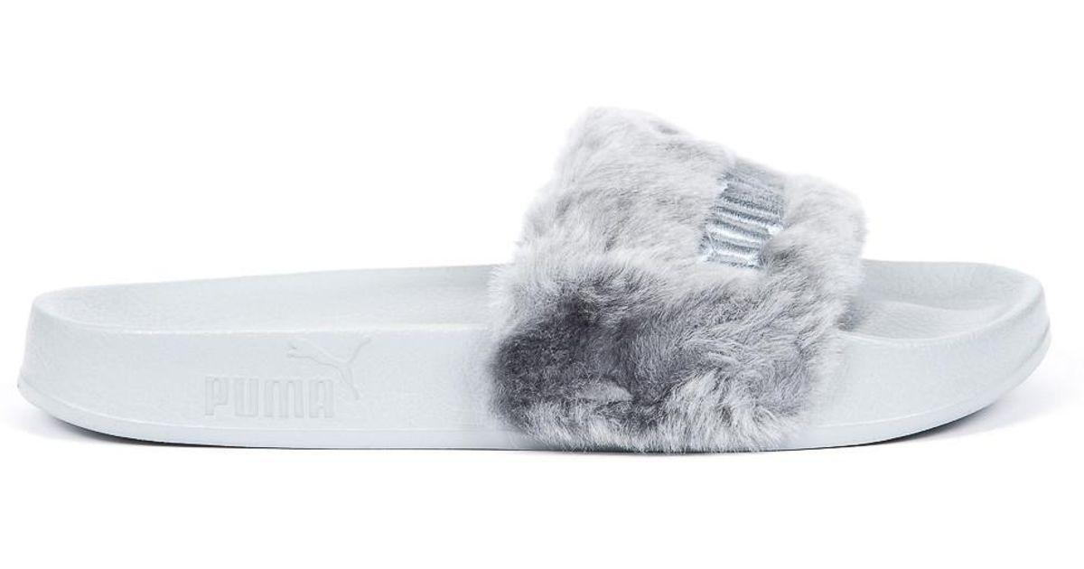 new photos ee09f 43c20 PUMA Brown X Rihanna Leadcat Fenty Fur Slides