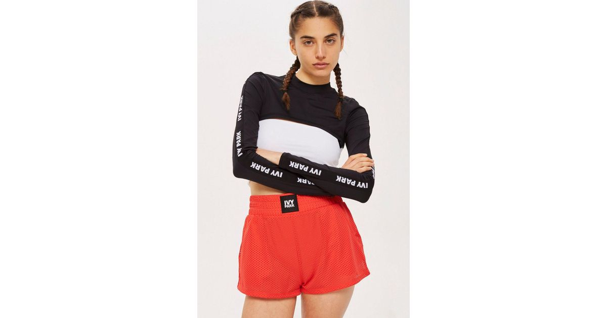8c01aeb88fb072 Lyst - TOPSHOP Long Sleeve Super Cropped Top By Ivy Park in Black