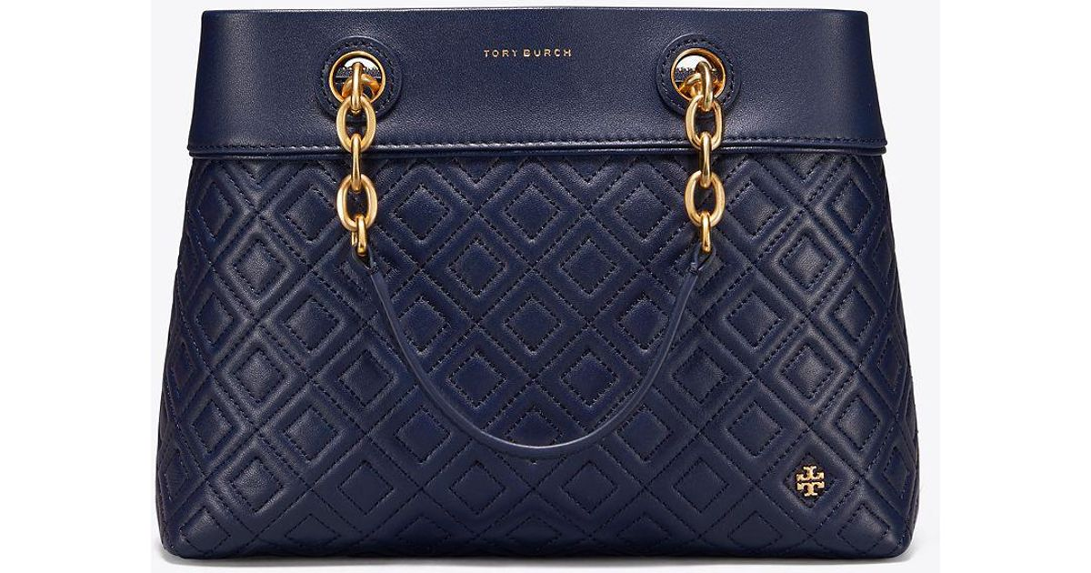 494a496f93cd ... ireland tory burch fleming small tote in blue save 18.723404255319153  lyst f3c6e c649d ...