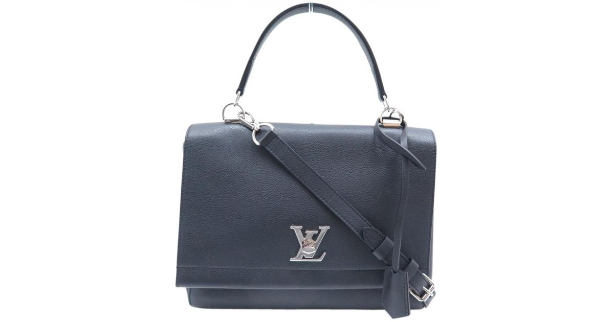 cb4e2d3a0797 Lyst - Louis Vuitton Lockme Leather Crossbody Bag in Black