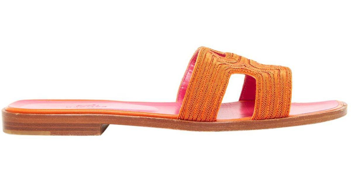 38453a875b33 Lyst - Hermès Oran Cloth Mules in Orange
