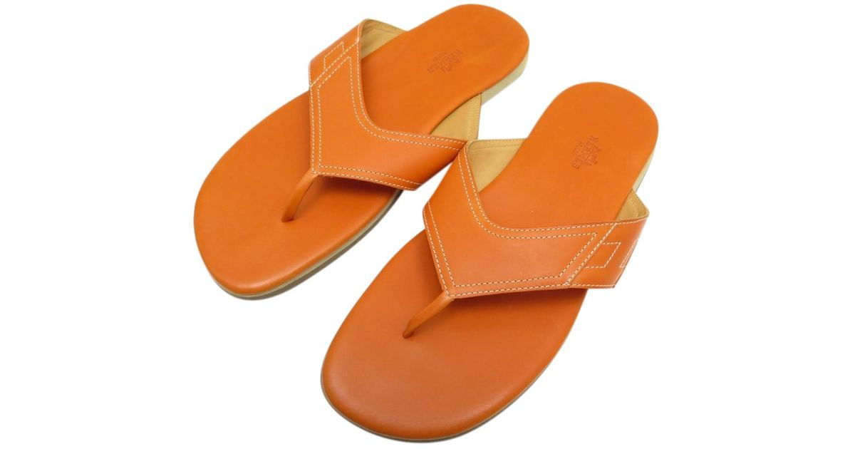d2bb51255500 Lyst - Hermès Leather Sandals in Orange for Men