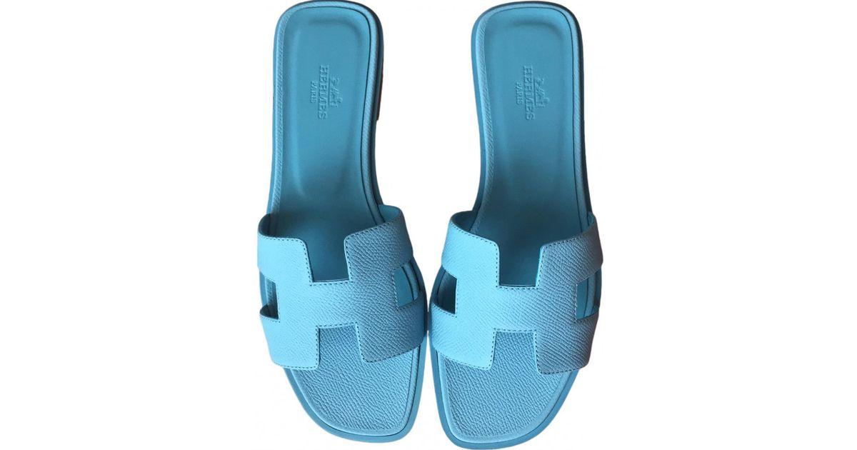 318299dfa45dd0 Lyst - Hermès Oran Leather Flip Flops in Blue
