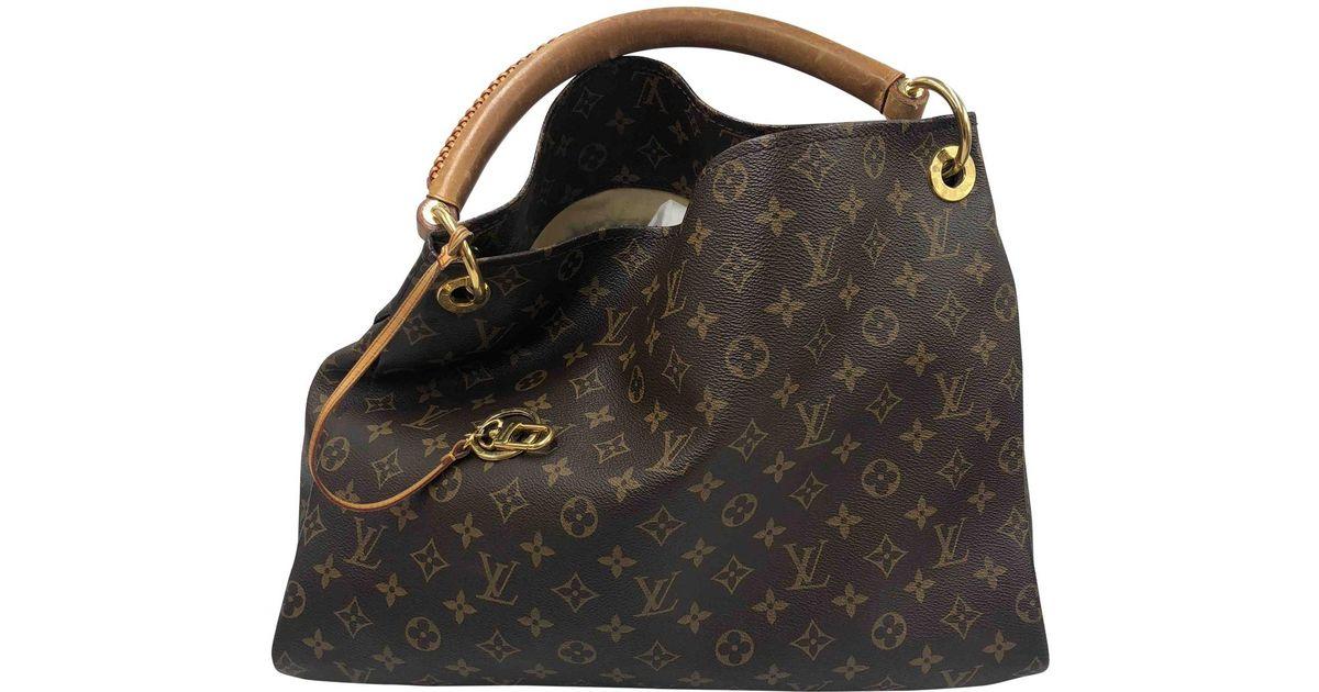02b380c739 Lyst - Louis Vuitton Artsy Cloth Handbag in Brown