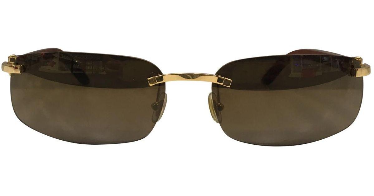 4cc835cc09 Lyst - Cartier Sunglasses in Brown