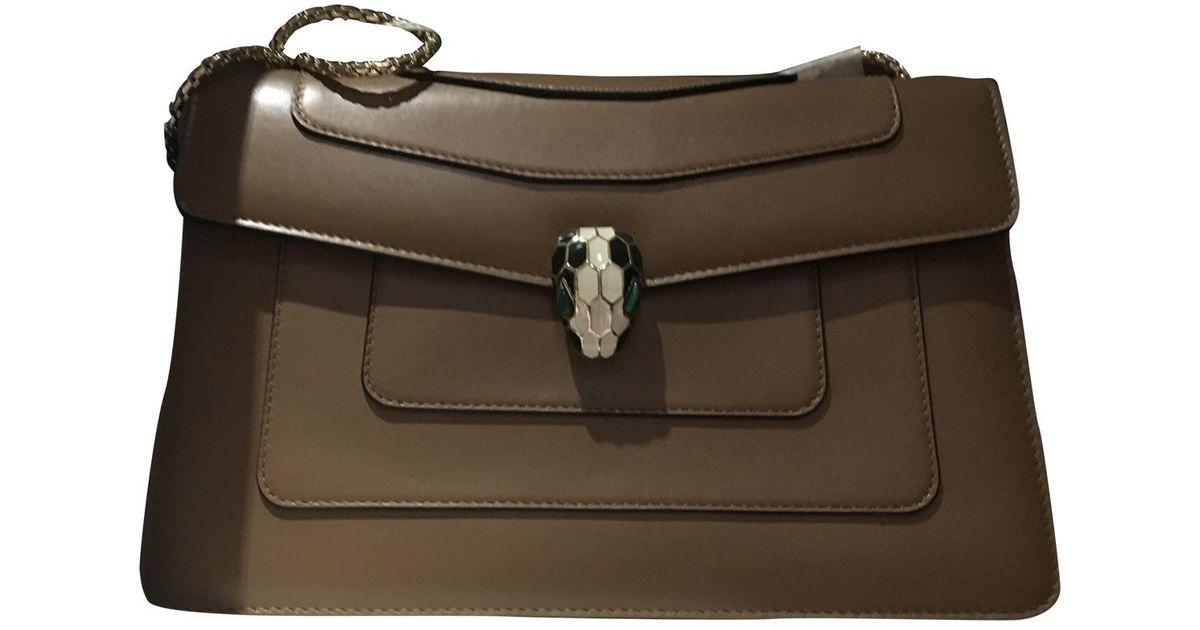 5056eccf19d Lyst - BVLGARI Serpenti Leather Handbag in Brown