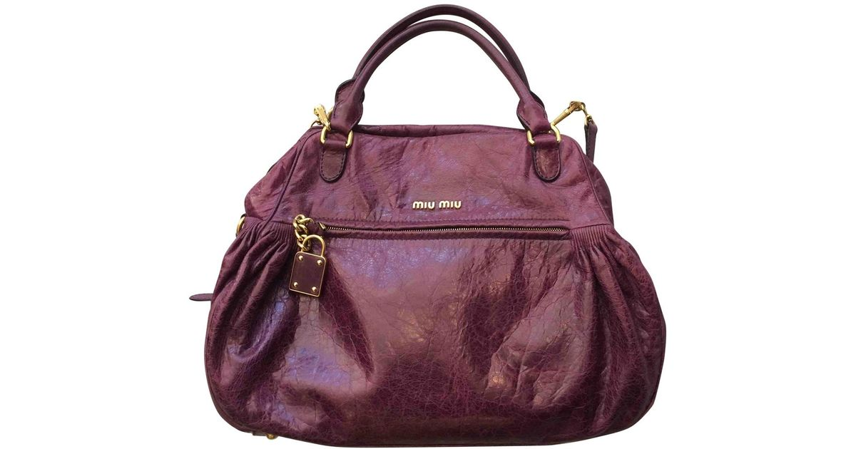 7c53e843c Lyst - Miu Miu Pre-owned Purple Leather Handbags in Purple