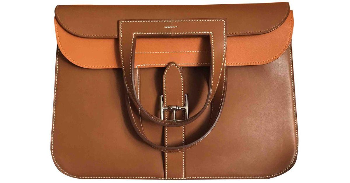 2042dd61dde0 Lyst - Hermès Halzan Leather Handbag in Brown