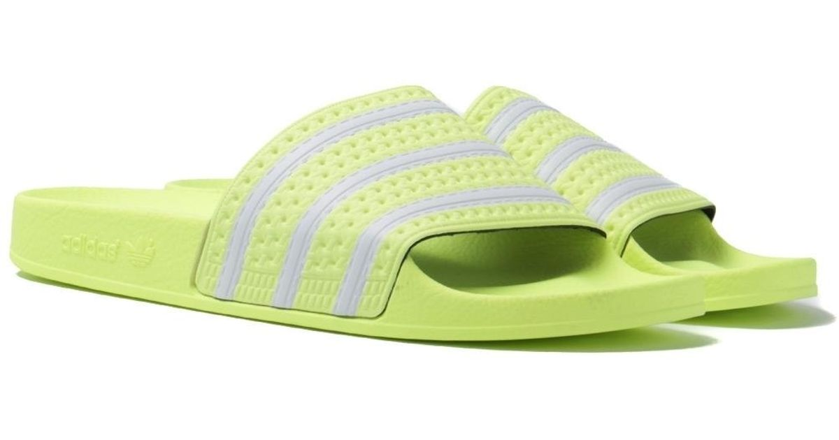 6c1329807 adidas Originals Adilette Neon Yellow Slides in Yellow for Men - Lyst