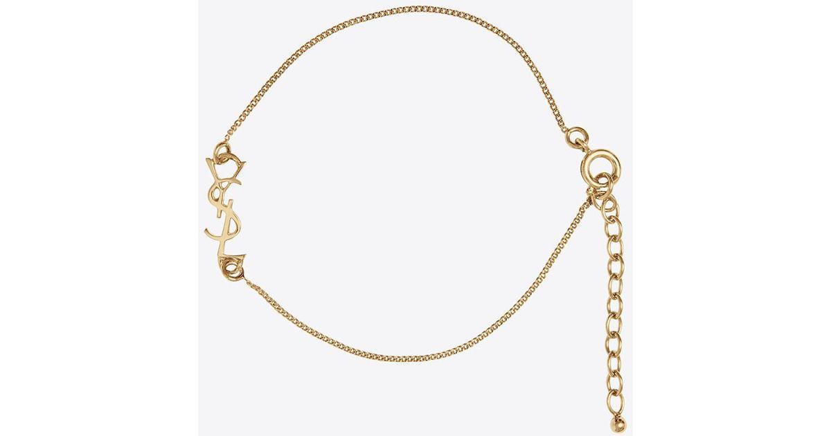d0d7183cea46a Saint Laurent Metallic Charm Bracelet In Gold Brass