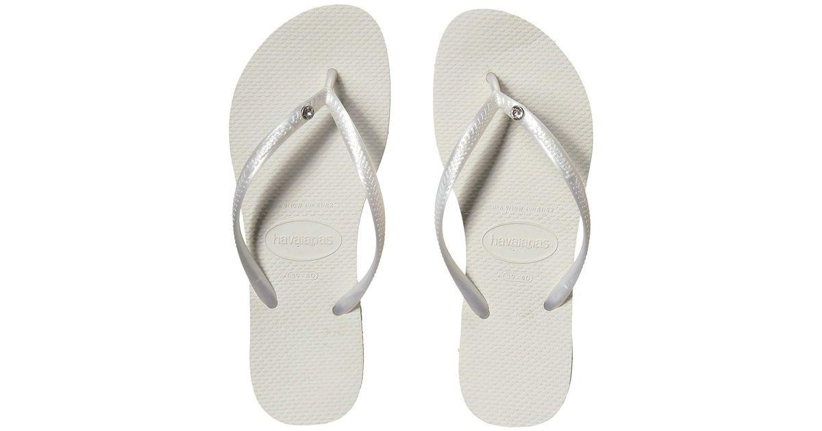 6a71a704a Lyst - Havaianas Slim Crystal Glamour Sw Flip Flops (black) Women s Sandals  in Metallic