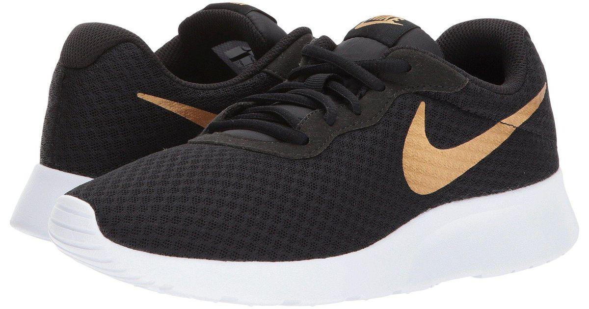 Lyst - Nike Tanjun (black black white) Women s Running Shoes in Black cc29310f5
