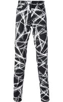 McQ by Alexander McQueen Graffiti Print Trousers - Lyst