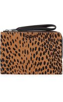 Elizabeth And James Pyramid Spotted Slim Wristlet Clutch Bag Cognacblack - Lyst