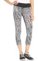 Nike Epic Run Printed Dri-fit Capri Leggings - Lyst