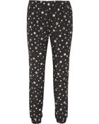 Tibi Star Fields Printed Crepe Track Pants - Lyst