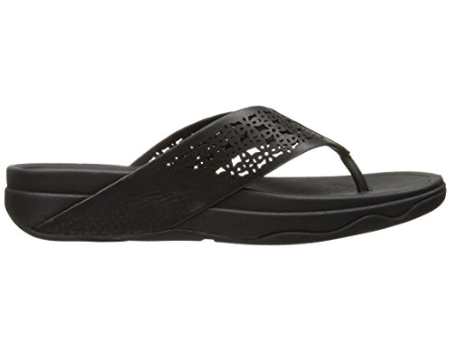 61b24c410 Lyst - Fitflop Leather Lattice Surfa Floral Flip Flops in Black - Save 5%