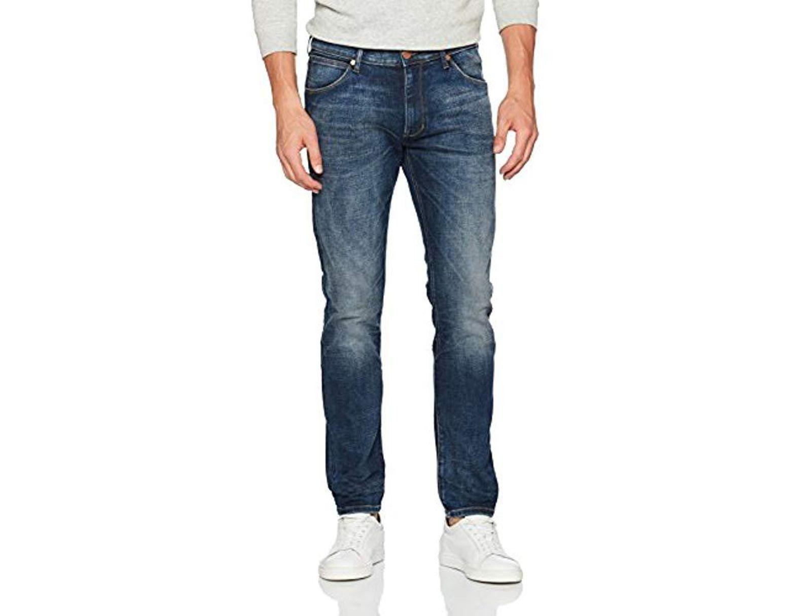 9070ddbdb44df Wrangler Larston Slim Tapered Fit Jeans in Blue for Men - Save 63 ...