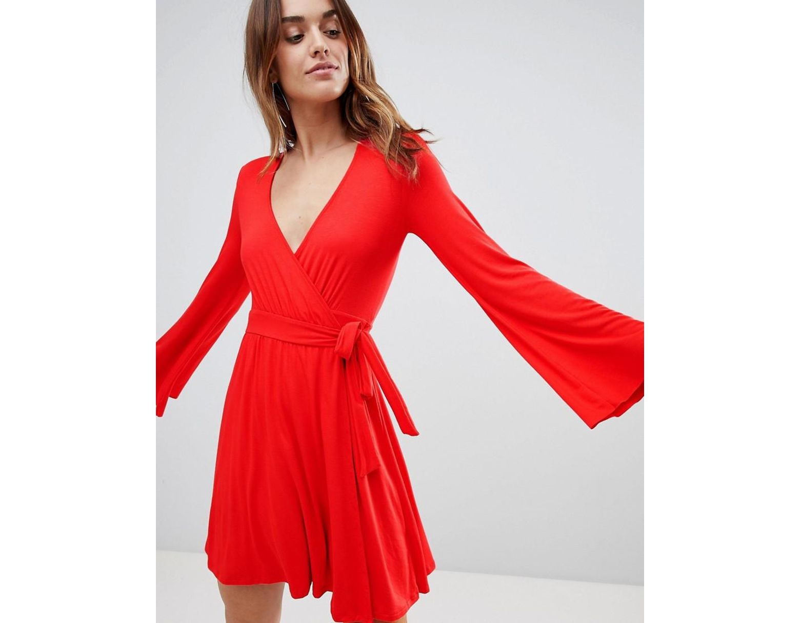 596193e853ac Ivyrevel Wrap Front Mini Skater Dress With Flueted Sleeve in Red - Lyst