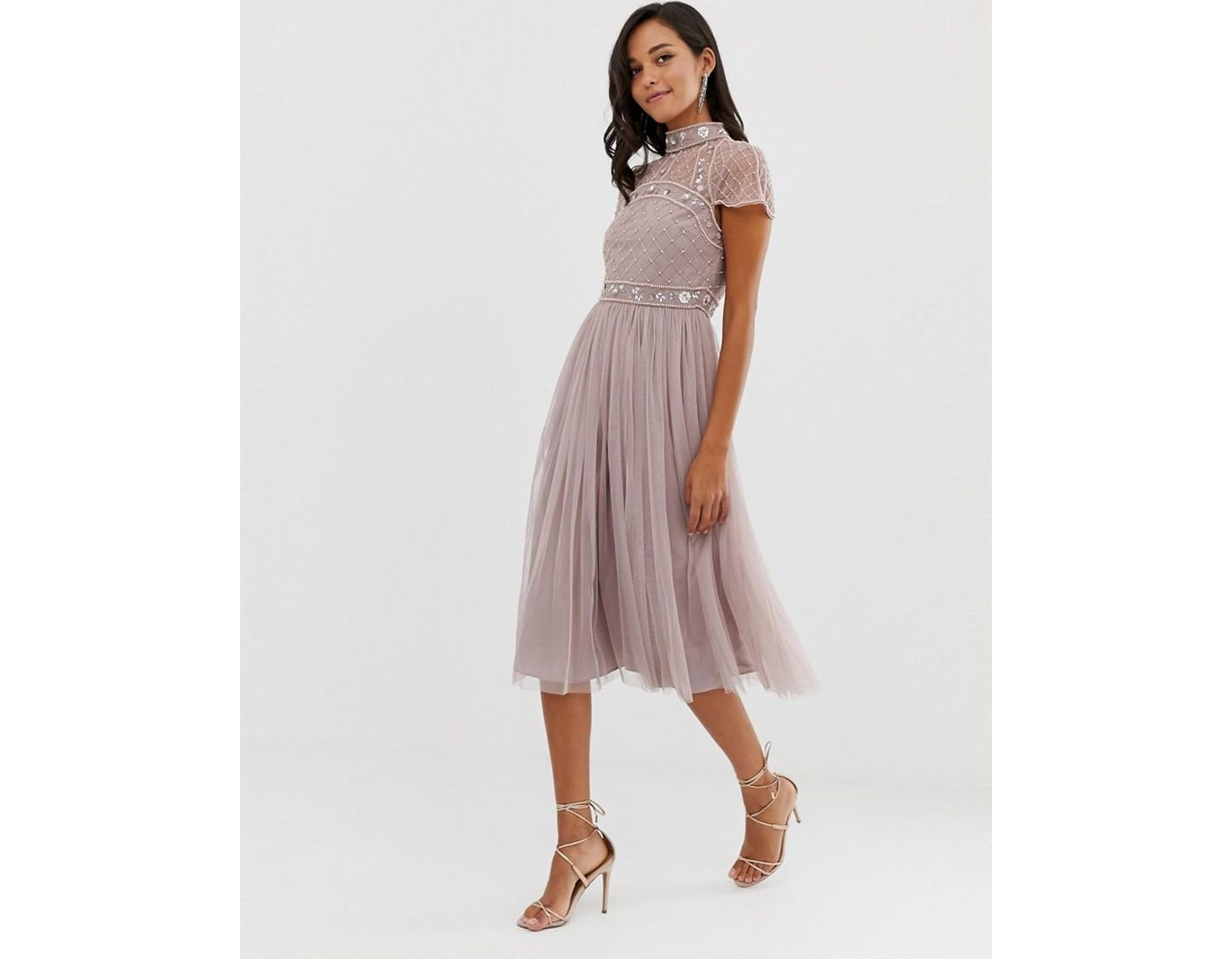 9edb6fb14 Vestido midi con top corto adornado y falda de tul de mujer