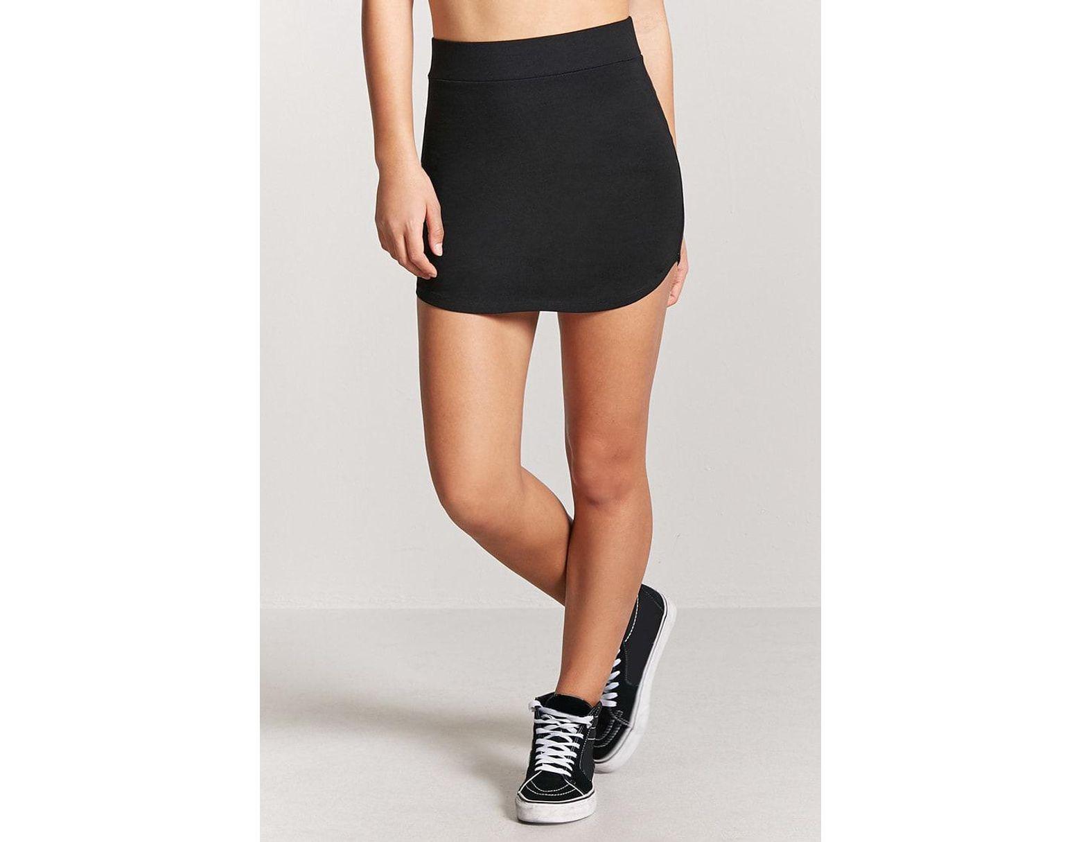 0e24fb49b Minifalda bajo curvado de mujer de color negro