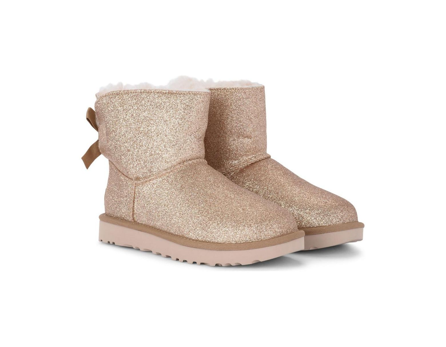 9228ac621 UGG Mini Bailey Bow Sheepskin And Golden Glitter Ankle Boots Women's Snow  Boots In Gold in Metallic - Lyst