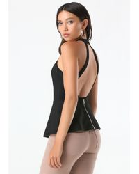 Bebe - Black Backless Peplum Sweater - Lyst