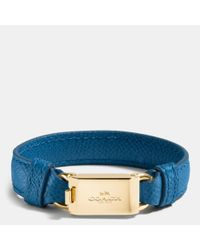 COACH - Blue Leather Horse And Carriage Id Bracelet - Lyst