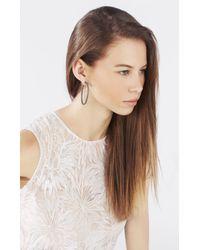 BCBGMAXAZRIA | Metallic Pave Oval Hoop Earrings | Lyst