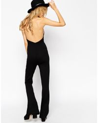 ASOS - Black Flare Jumpsuit With Halter Neck - Lyst