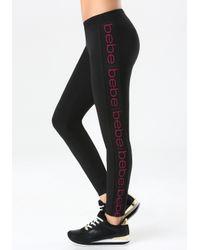Bebe - Black Vertical Logo Leggings - Lyst