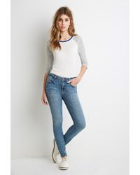 Forever 21 - Blue Faded Mid-rise Skinny Jeans - Lyst