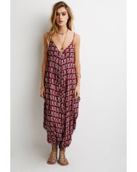44c4a6cbe21 Lyst - Forever 21 Ornate Print Harem Jumpsuit in Red