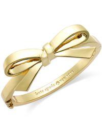kate spade new york | Metallic New York Goldtone Bow Hinge Bangle Bracelet | Lyst