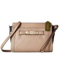 COACH | Pink Color Block Pebbled Leather Swagger Wristlet | Lyst