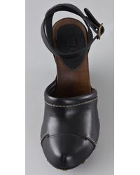 See By Chloé Black Closed Toe Wedge Sandals