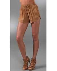 Shakuhachi | Natural Utility Snap Shorts | Lyst