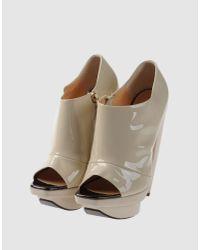 Pollini - Natural Patent Peep-toe Shoe Boots - Lyst