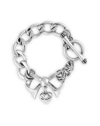 Juicy Couture | Metallic Bow Starter Charm Bracelet | Lyst