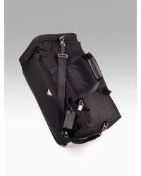 Prada | Black Nylon/leather Roll Duffle Bag for Men | Lyst