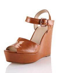 Kors by Michael Kors | Brown Carmila Patent Leather Wedge Sandal | Lyst