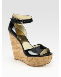 071246f72db Lyst - MICHAEL Michael Kors Ariana Patent Leather Cork Wedge Sandals ...