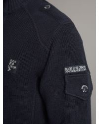 Duck and Cover Blue Half Zip Through Ribbed Top for men