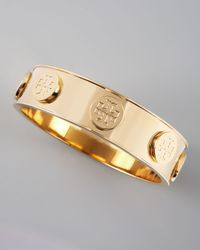 Tory Burch - Metallic Logostud Bangle Golden - Lyst