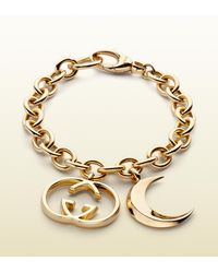 Gucci Metallic Bracelet with Half Moon and Interlocking G Motif Charms