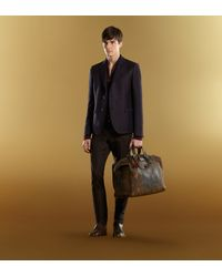Gucci Brown Goldmark Grainy Leather Duffle Bag for men