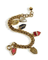 Juicy Couture | Metallic Gold Assembled Shield Charm Bracelet | Lyst