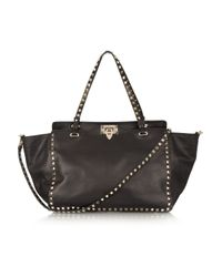 Valentino | Black The Rockstud Leather Trapeze Bag | Lyst